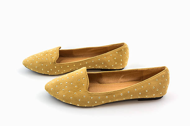 brown flat shoes. - flat shoe stock photos and pictures