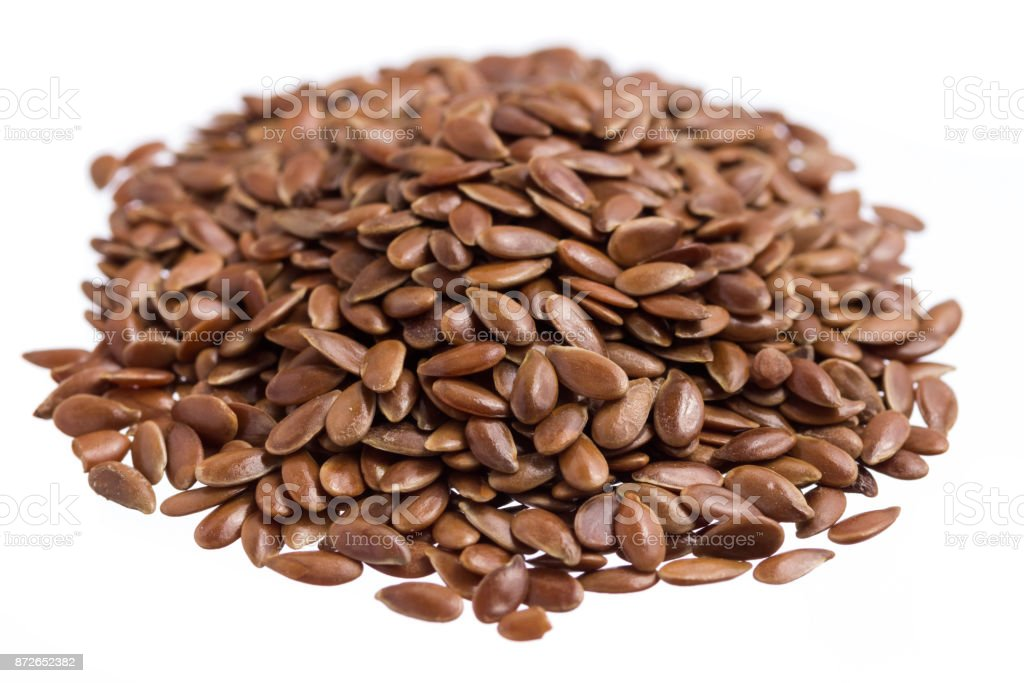 Brown Flax. Pile of grains, isolated white background. stock photo