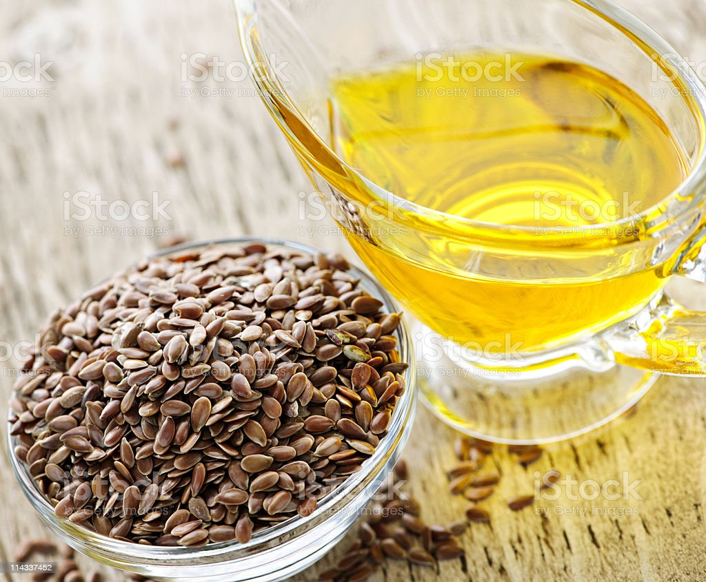 Brown flax seed and linseed oil royalty-free stock photo