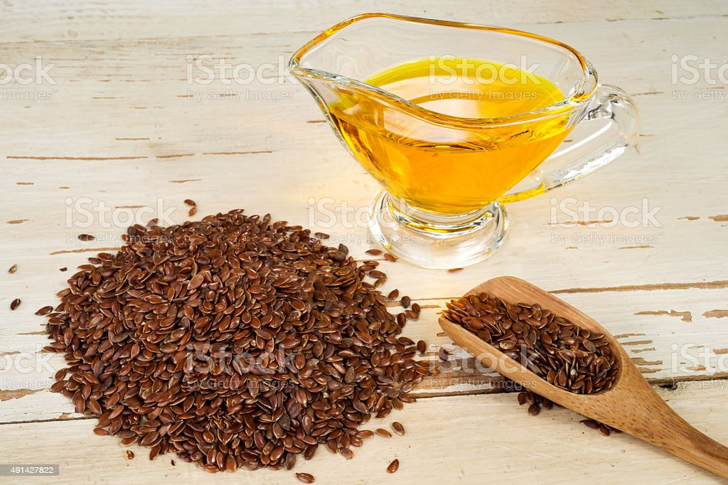 brown flax seed and linseed oil stock photo