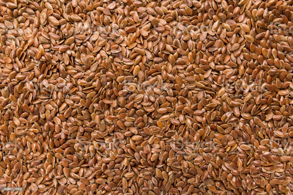 Brown Flax seed. Closeup of grains, background use. stock photo