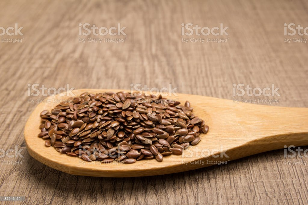 Brown Flax seed. Grains in wooden spoon. Rustic. stock photo