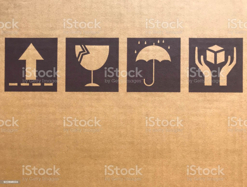 Brown fragile symbols on cardboard or carton stock photo