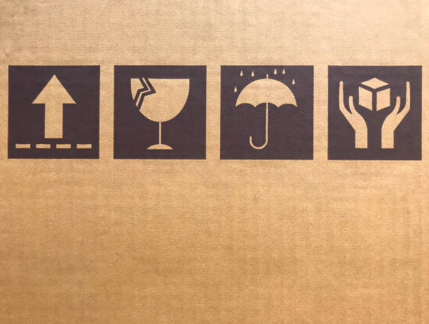 brown fragile symbols on cardboard or carton - fragile stock photos and pictures