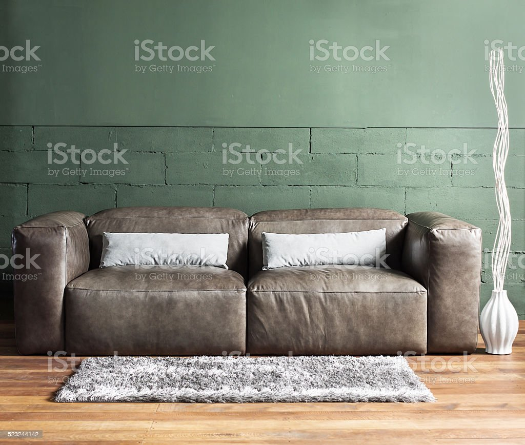 Brown furniture and concrete wall with spot lighting,shallow Depth of...