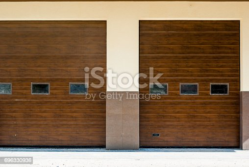istock Brown Gate garage for large car. 696330936