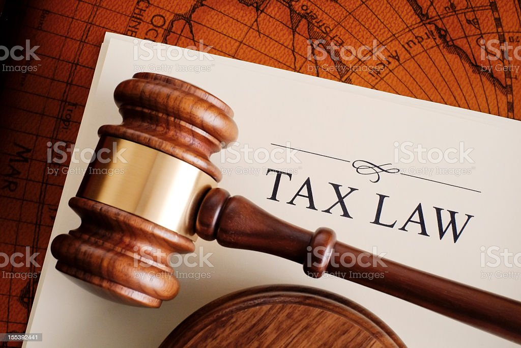 Brown gavel on a white tax law document stock photo