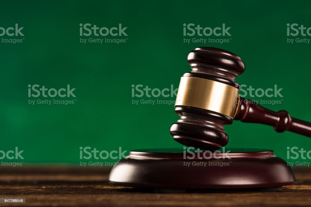brown gavel with a brass band stock photo