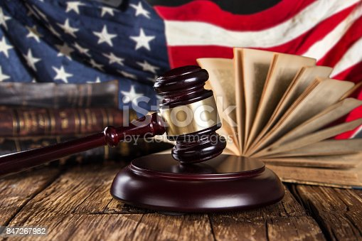 istock Brown gavel with a brass band with american flag 847267982
