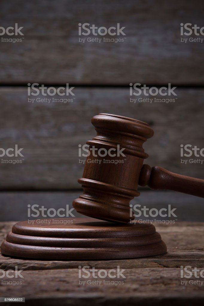 Brown gavel with a stand. stock photo
