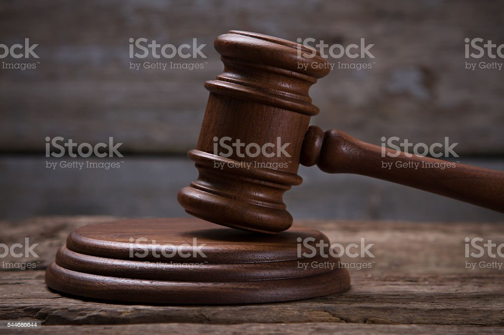 Brown gavel with stand. stock photo
