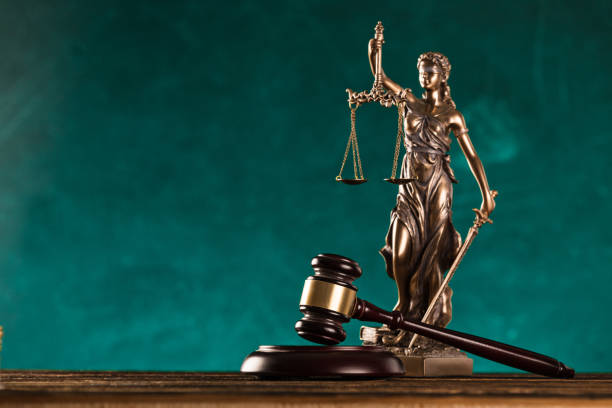 brown gavel with statue of justice. stock photo