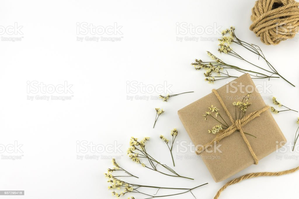 Brown gift boxes and rope with yellow limonium caspia flowers stock photo