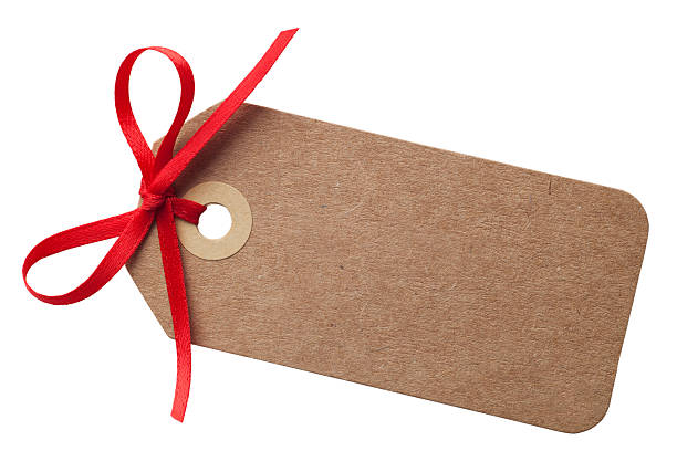 Brown Gift Tag with Red Bow stock photo