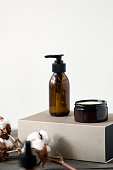 istock Brown glass cosmetic bottle and jar against white 1208506290