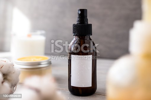 1167558793 istock photo Brown glass cosmetic bottles with white label 1004889938