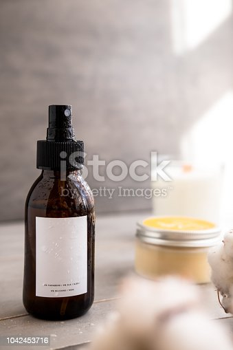 1167558793 istock photo Brown glass cosmetic bottles with white label 1042453716