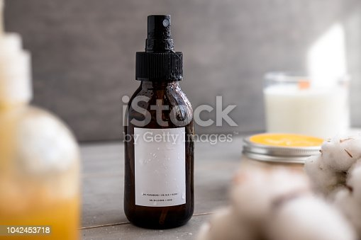 1167558793 istock photo Brown glass cosmetic bottles with white label 1042453718