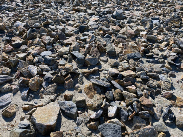 brown grey sand stone rocks perspective view with deep shadows and bright details as backdrop background for website architecture presentation scenery stock photo