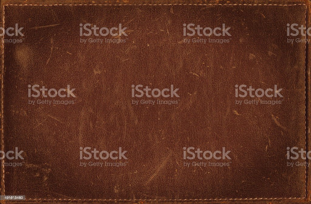 Brown grunge background from distress leather texture with stitched frame stock photo