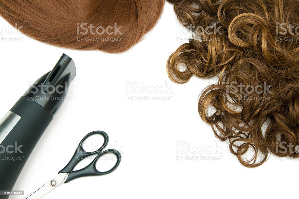 Brown hair and red hair with hair dryer and scissors stock photo