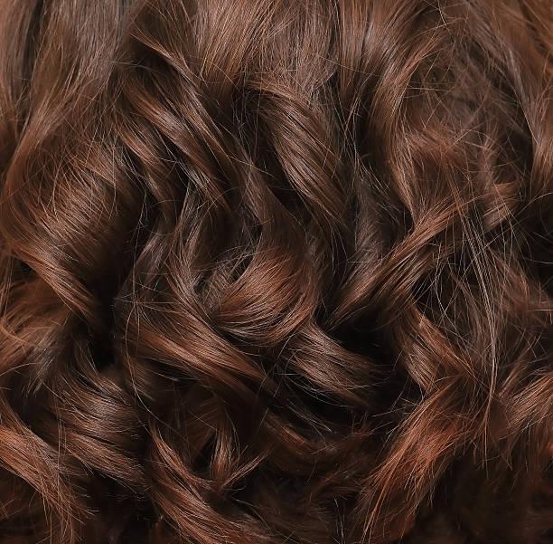 brown hair lock closeup - dauerwelle stock-fotos und bilder