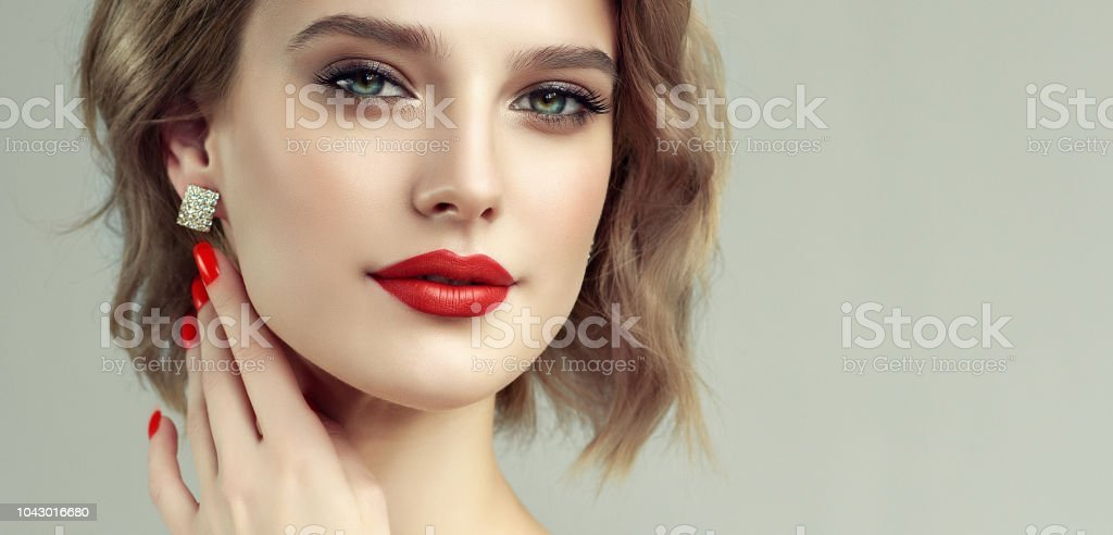 Brown Haired Attractive Woman With Trendy Middlelength Haircut