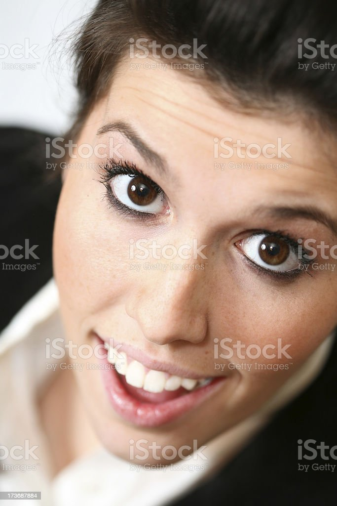 Brown haired, brown eyed woman smiles for the photographer. royalty-free stock photo