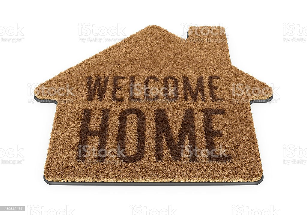 Brown house shape welcome mat stock photo