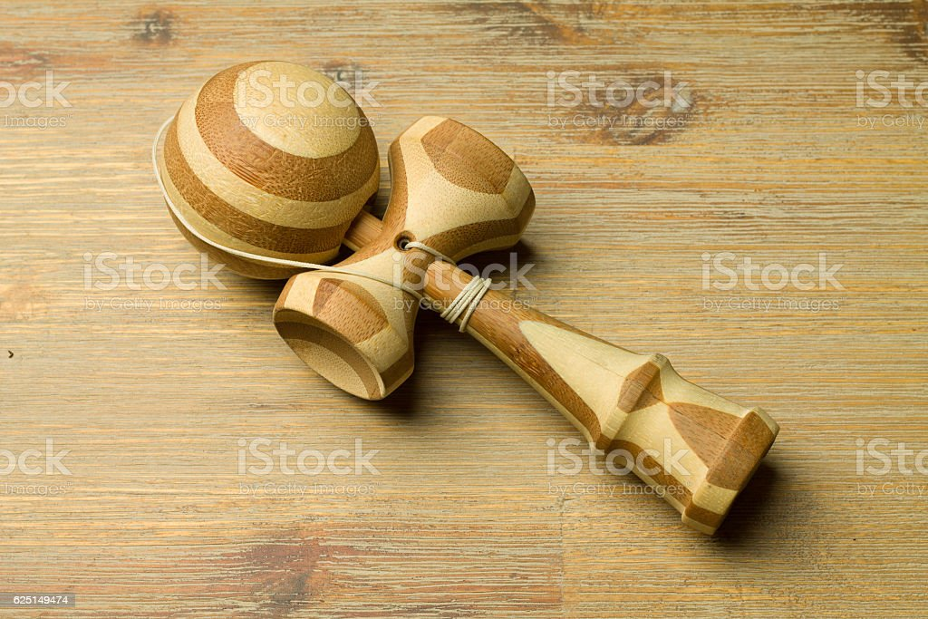 Brown kendama on a wooden table stock photo