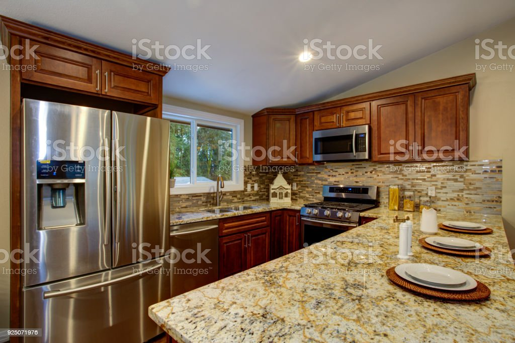 Brown Kitchen Design With Mahogany Kitchen Cabinets Stock Photo Download Image Now Istock