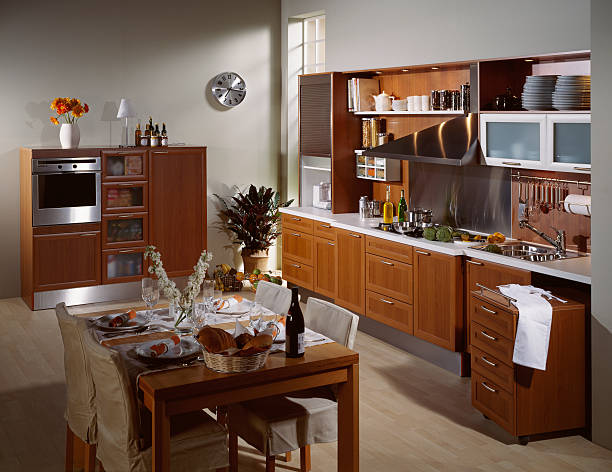 Brown Kitchen Large kitchen with a table for 4 grifare stock pictures, royalty-free photos & images