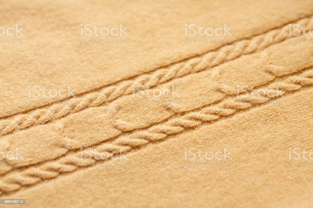 Brown knitted woolen background royalty-free stock photo