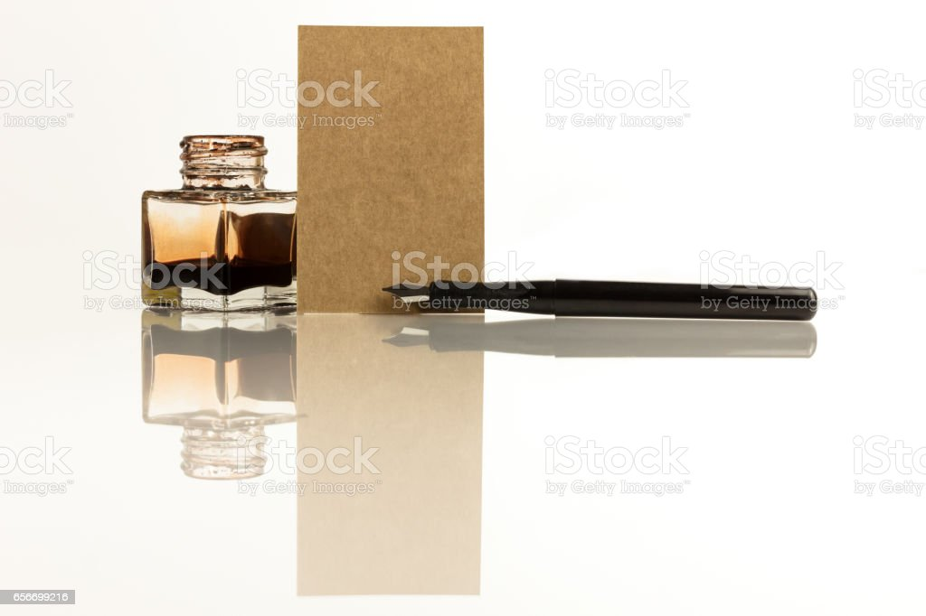 Brown kraft business card with ink pen and copyspace stock photo