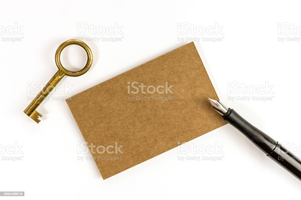 Brown kraft business card with key and ink pen stock photo