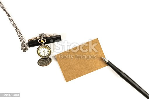 istock Brown kraft business card with watch and ink pen 658920400