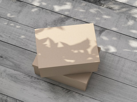 Brown kraft carton Gift Box Mockup on the wooden table outdoor. 3d rendering