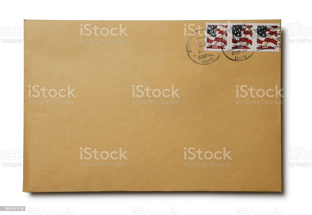 Brown kraft envelope with canceled U.S. stamps on white background stock photo