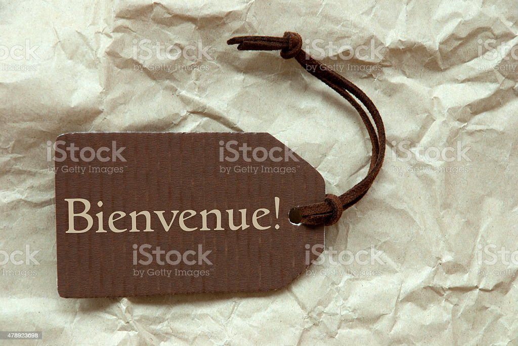Brown Label With French Bienvenue Means Welcome stock photo