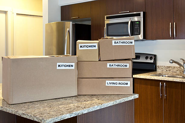 Brown labeled moving boxes stacked on a kitchen island picture id186815484?b=1&k=6&m=186815484&s=612x612&w=0&h=d0bhei9bcy1yipi10w a4n7du5ksencqhy6qpxhgnmy=