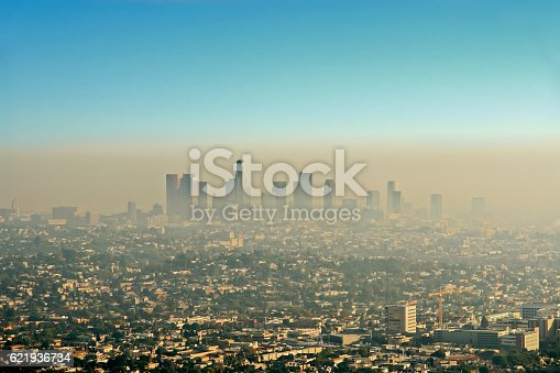 Wide shot of the downtown Los Angeles skyline bathed in smog. View from Griffith Park