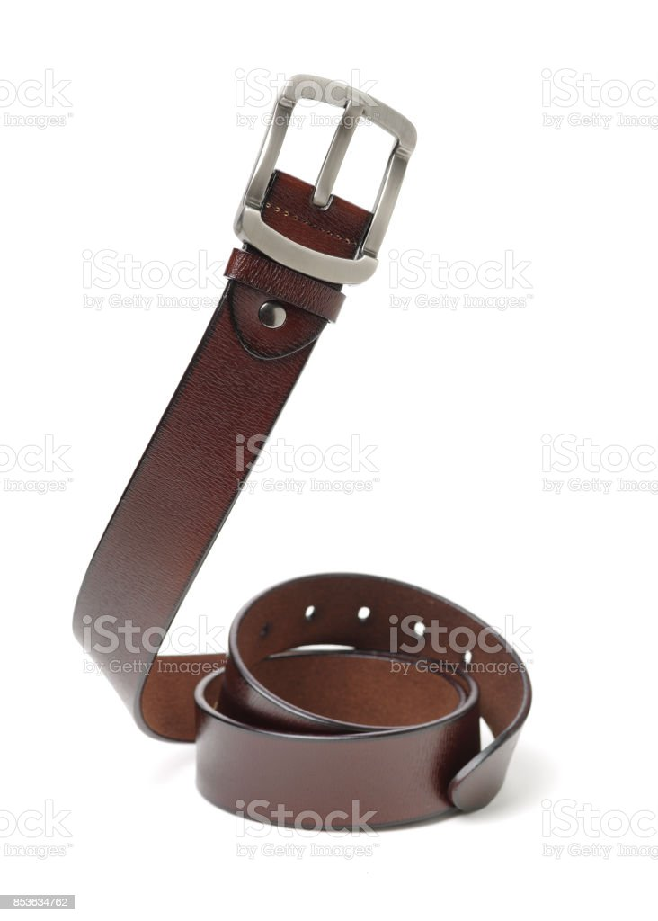 Brown leather belt, isolated on white background stock photo