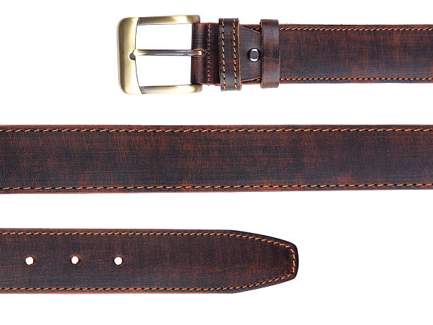 brown leather belt isolated on white - belt stock photos and pictures