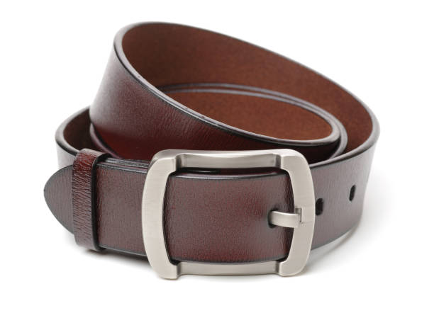 brown leather belt  on white background closeup - belt stock photos and pictures