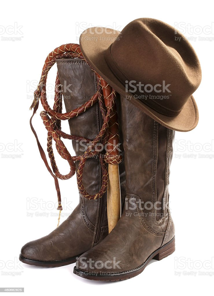Brown leather boots, hat and whip stock photo
