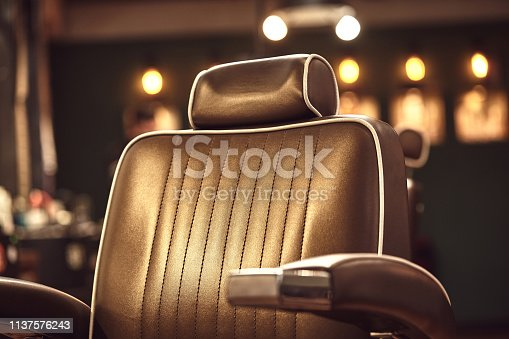 1131824191 istock photo Brown leather chair in barbershop. Loft style 1137576243