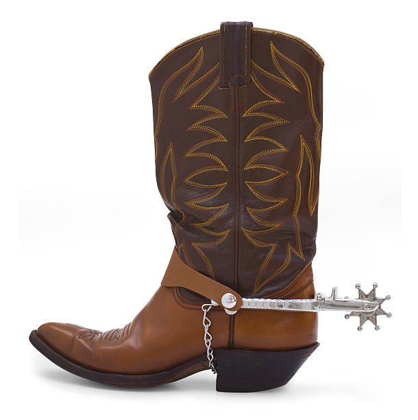 A brown leather cowboy boot with a pointed toe stock photo