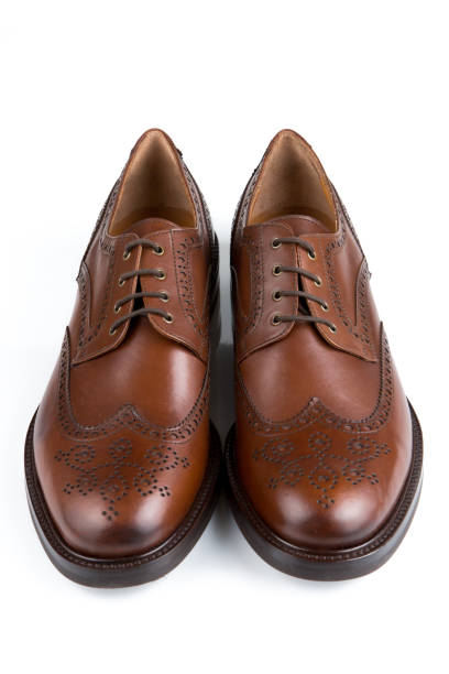 Brown leather male Oxfords shoes stock photo