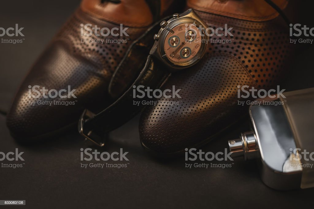 brown leather men's accessories. Shoes with perfume and watch stock photo