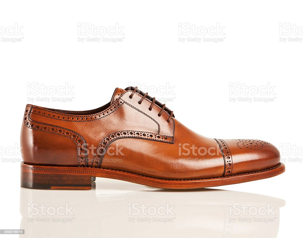 brown leather men's shoe isolated on white stock photo